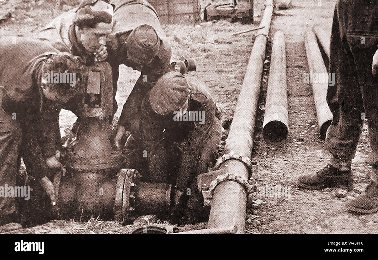 WWII - British soldiers constructing ' Operation Pluto', (Pipe-Lines Under The Ocean or Pipe-Line Underwater Transportation of Oil )the pipeline used  to pump fuel oil over the English channel to France to support Operation Overlord. The scheme was developed by Arthur Hartley, chief engineer with the Anglo-Iranian Oil Company Stock Photo