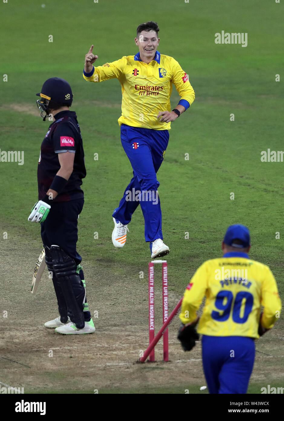 Durham's Matthew Potts, top, celebrates bowling out Northamptonshire's Josh Cobb during the Vitality Blast T20 match at Emirates Riverside, Durham. - Stock Image