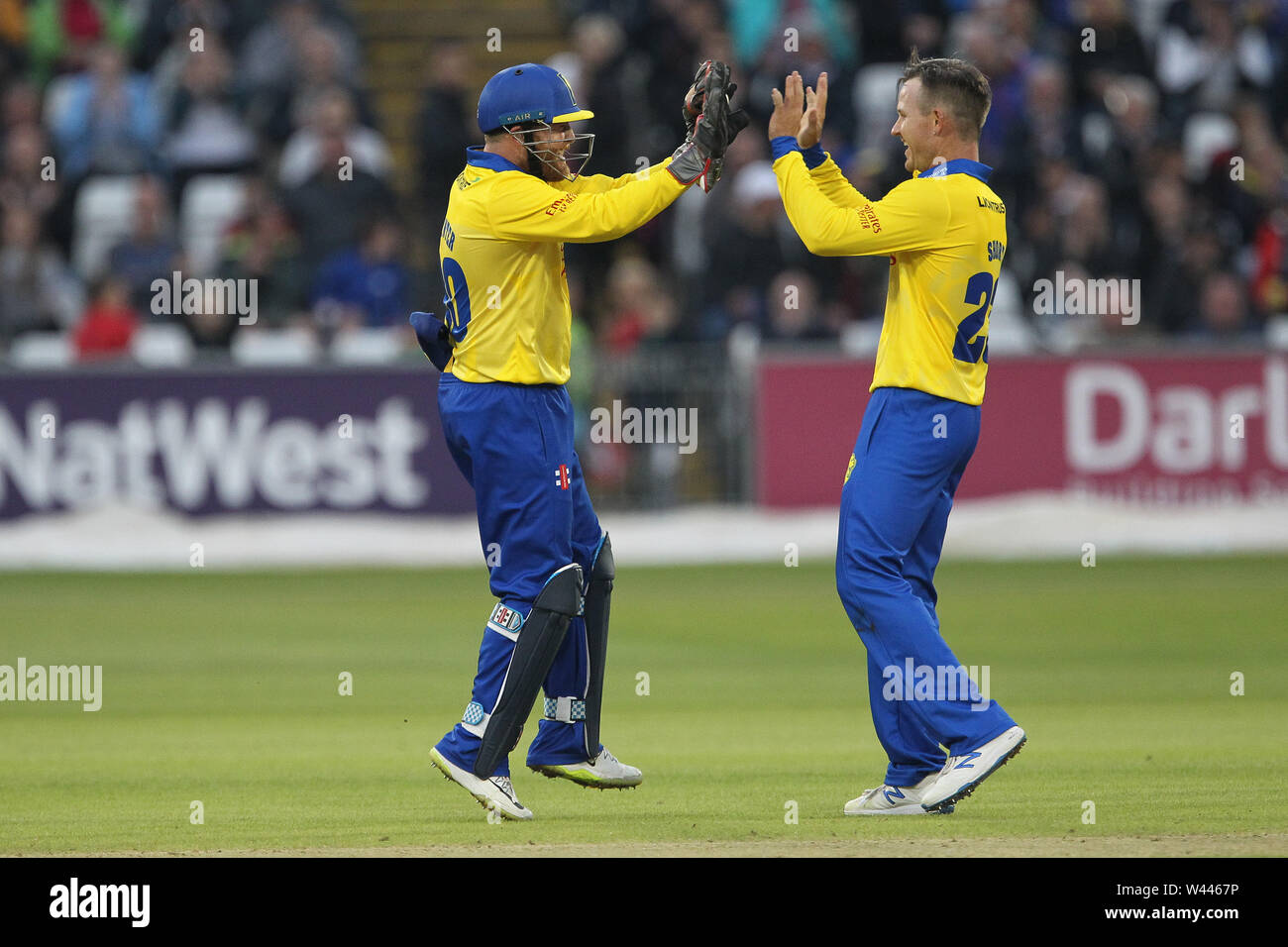 CHESTER LE STREET, ENGLAND 19th July 2019. Durham's Stuart Poynter and D'arcy Short celebrate after Poynter caught Adam Rossington off Short's bowling during the Vitality T20 Blast match between Durham County Cricket Club and Northamptonshire County Cricket Club at Emirates Riverside, Chester le Street on Friday 19th July 2019. (Credit: Mark Fletcher   MI News ) Credit: MI News & Sport /Alamy Live News - Stock Image