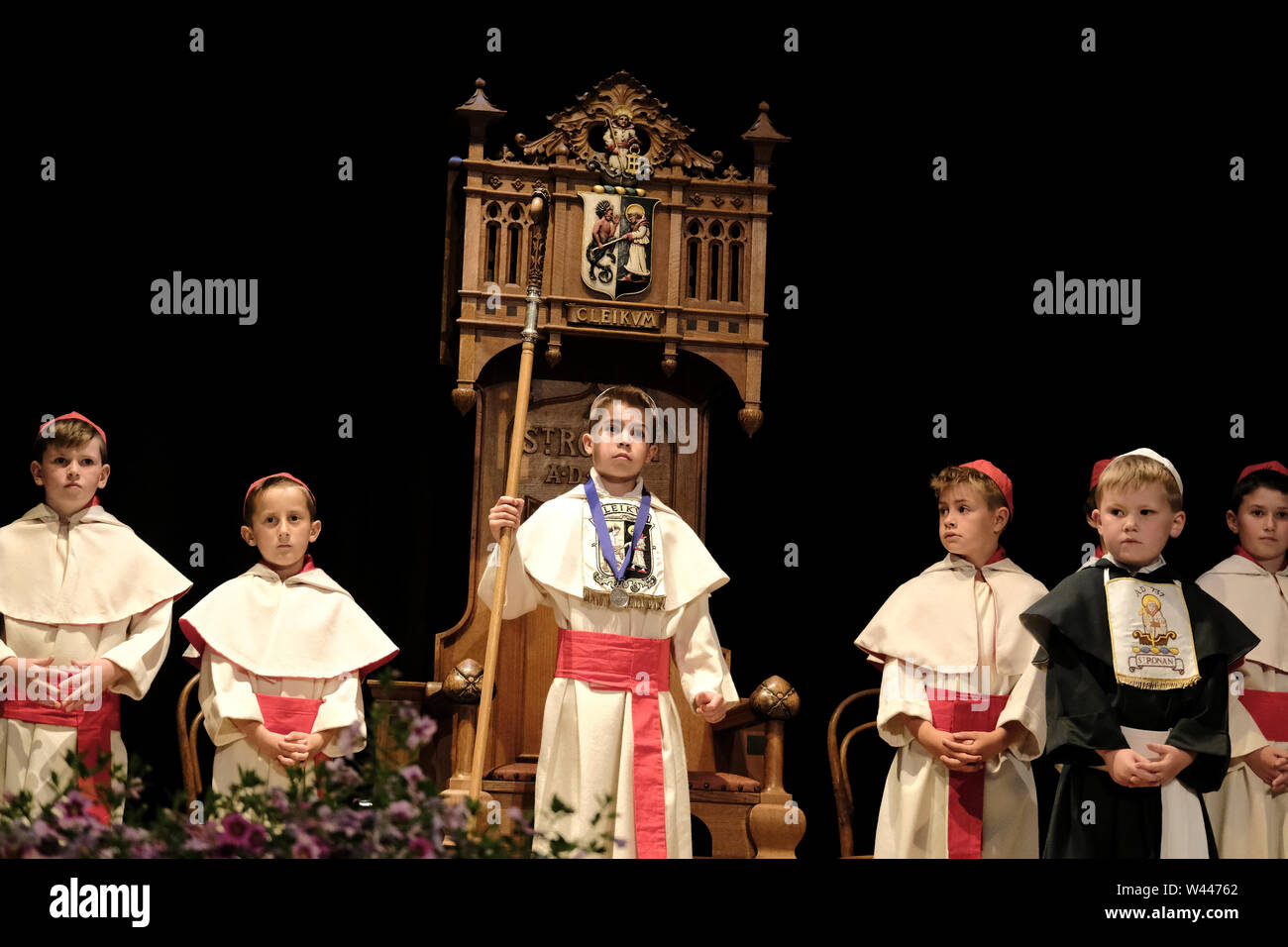 Innerleithen, UK. 19th July, 2019. St Ronans Cleikum Dux Boy of St RonanÕs School Aaron R Glendinning (centre) after his installation at the Cleikum Ceremonies in Memorial Hall, Innerleithen. as part of St Ronans Games Week, Friday 19 July 2019 . Instituted in 1827, The Games are the oldest organised sports meeting in Scotland and are now part of a week long festival that incorporates many events for every age group. Central to the festivities are the Cleikum Ceremonies when the town's association with its Patron Saint, St. Ronan, is celebrated ( Credit: Rob Gray/Alamy Live News - Stock Image