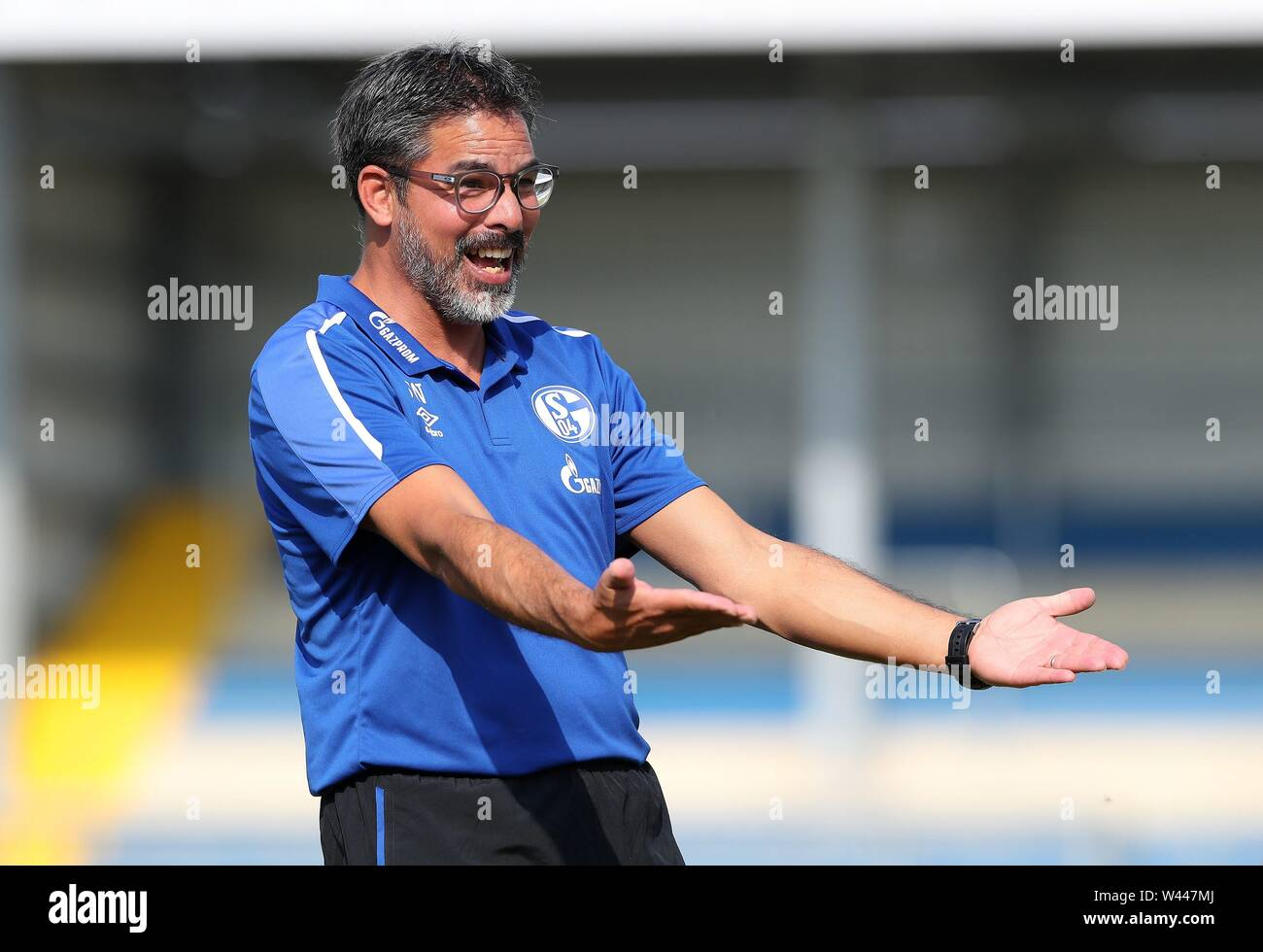 Lotte, Deutschland. 19th July, 2019. firo: 19.07.2019, football, 1.Bundesliga, season 2019/2020, friendly match, FC Schalke 04 - Norwich City coach David WAGNER, Schalke, gesture, laughs | Credit: dpa/Alamy Live News - Stock Image