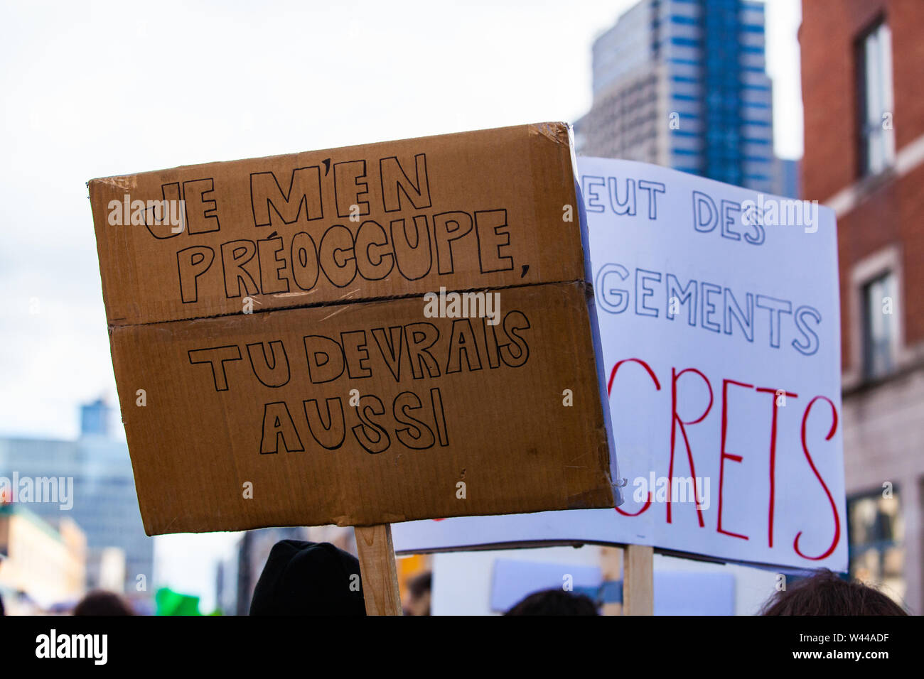 A French sign reads I do care, you should too as environmentalists march against climate change in Montreal, Canada. Stock Photo