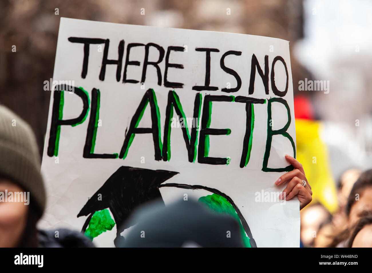 A closeup view of a homemade sign, saying there is no planet b, held by eco-activists during a march against climate change in the city. Stock Photo
