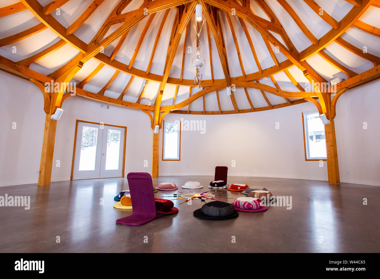Image of: A Wide Angled View Inside A Light And Airy Meditation Room With Exposed Rustic Beams In A Vaulted Ceiling Chairs And Cushions Are Prepared In A Circle Stock Photo Alamy