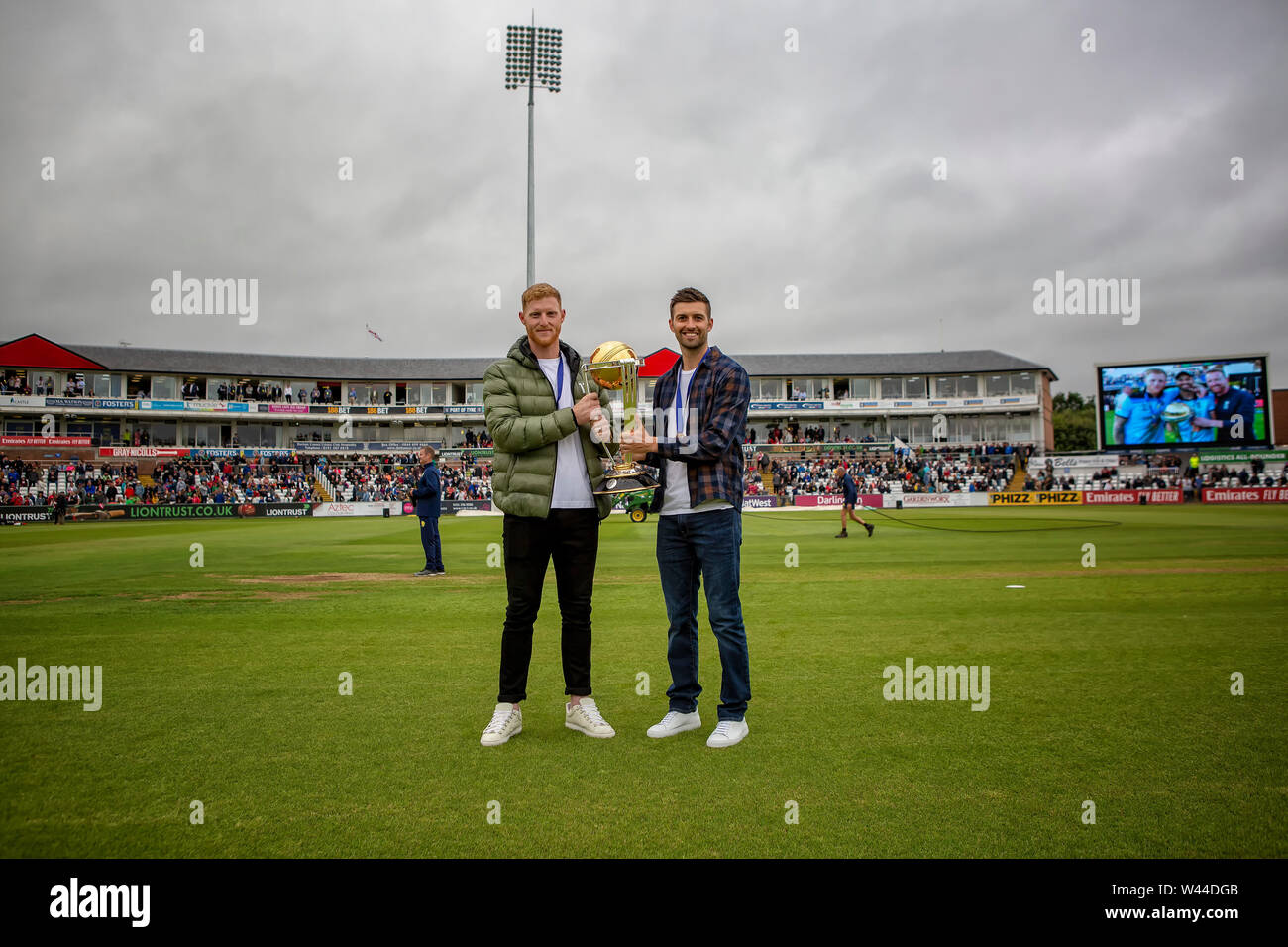 CHESTER LE STREET, ENGLAND. 19th July 2019. Mark Wood and Ben Stokes of Durham and England with the Cricket World Cup during the Vitality T20 Blast match between Durham County Cricket Club and Northamptonshire County Cricket Club at Emirates Riverside, Chester le Street on Friday 19th July 2019. (Credit: Mark Fletcher   MI News ) Credit: MI News & Sport /Alamy Live News - Stock Image