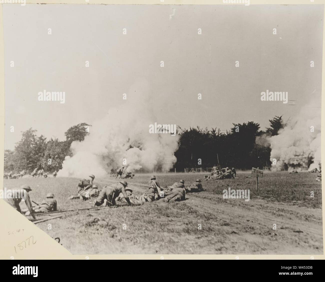 Companies M and K, Three hundred and twenty-sixth Infantry, Eighty-second Division, advancing on enemy positions, throwing hand grenades. Choloy, France - Stock Image