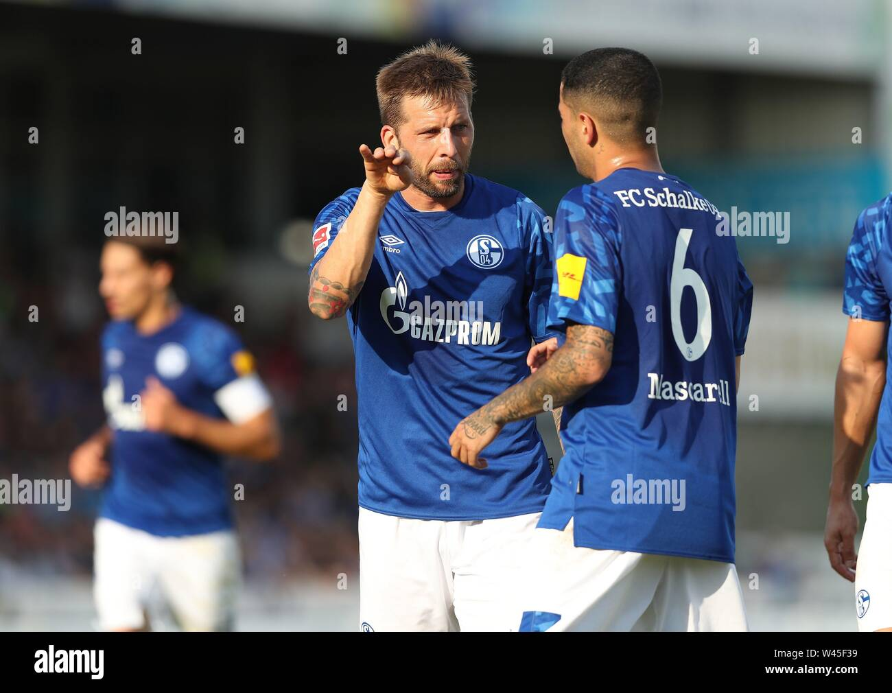 Lotte, Deutschland. 19th July, 2019. firo: 19.07.2019, football, 1.Bundesliga, season 2019/2020, friendly match, FC Schalke 04 - Norwich City Guido BURGSTALLER, Schalke, left with MASCARELL | usage worldwide Credit: dpa/Alamy Live News - Stock Image