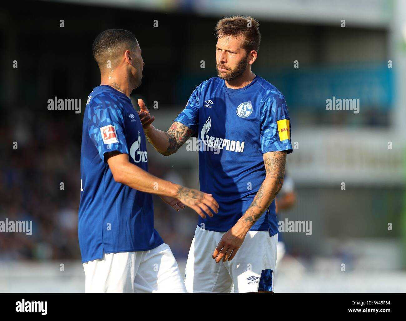 Lotte, Deutschland. 19th July, 2019. firo: 19.07.2019, football, 1.Bundesliga, season 2019/2020, friendly match, FC Schalke 04 - Norwich City Guido BURGSTALLER, Schalke, right with MASCARELL | usage worldwide Credit: dpa/Alamy Live News - Stock Image