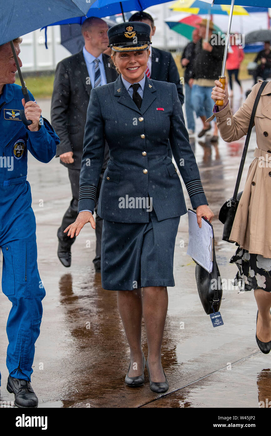 Astronaut Tim Peake and Carol Vorderman brave the rain in uniform at the Royal International Air Tattoo at RAF Fairford in Gloucestershire. Stock Photo