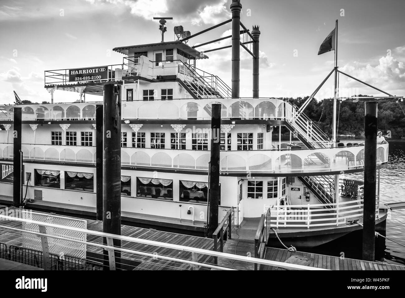 The Harriott II Riverboat, awaiting tourists for river cruises docked at the Riverwalk Park wharf in Montgomery, AL, USA, in black and white Stock Photo