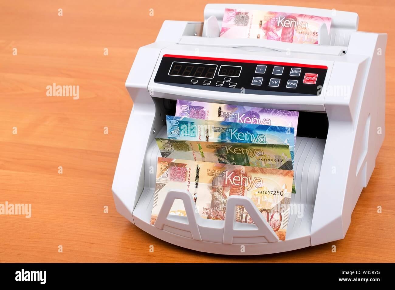 Kenyan Shillings in the counting machine Stock Photo
