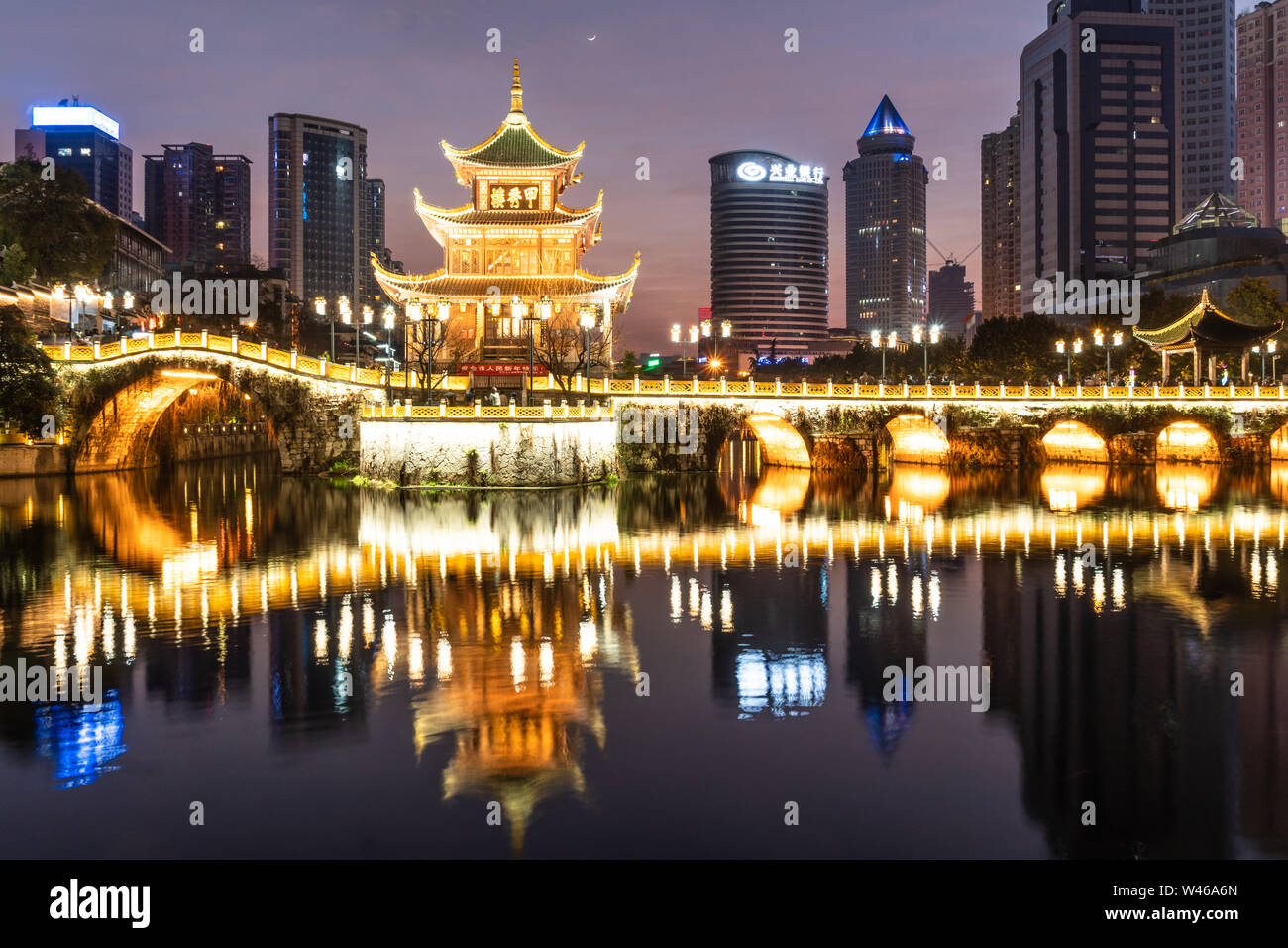 Guiyang, China - February 9 2019: Twilight over the famous Jiaxu tower in the heart of Guiyang downtown district in Guizhou province in China. Stock Photo
