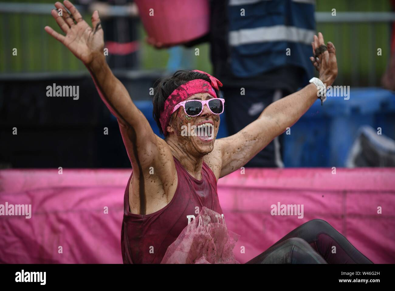 Swansea, Wales, UK. 20th July 2019 Pictured are fundraisers during the Cancer Research UK's Pretty Muddy event in Swansea, South Wales on Saturday. The participants, mainly women, scrambled over a number of muddy challenges on the 5k course in the cities Singleton Park, raising thousands of pounds for the charity. Credit : Robert Melen/Alamy Live News. Stock Photo