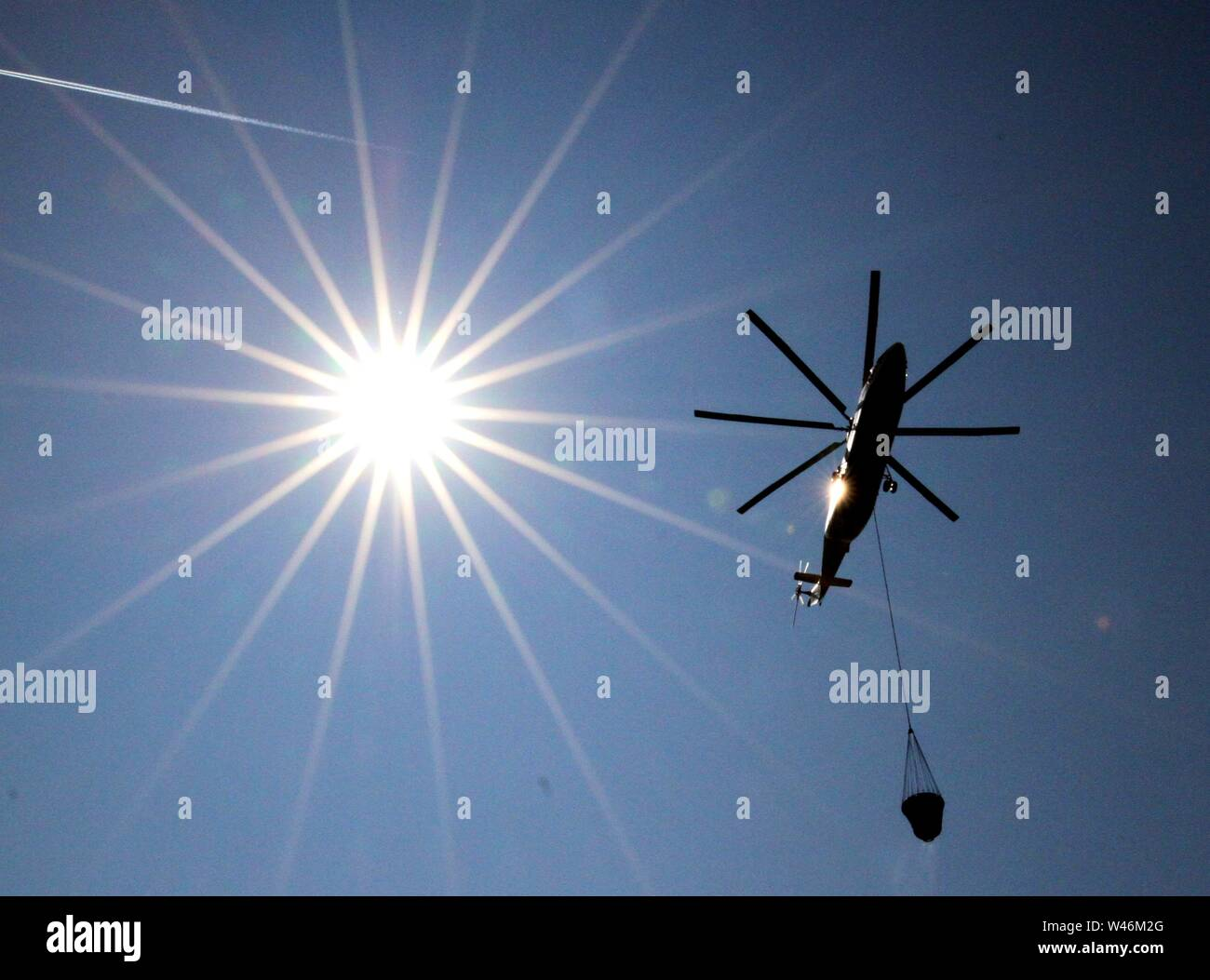 Minsk, Belarus. 20th July, 2019. A firefighting helicopter flies past during an event to honor firefighters and rescuers, in Minsk, Belarus, July 20, 2019. Credit: Zhinkov Henadz/Xinhua/Alamy Live News - Stock Image