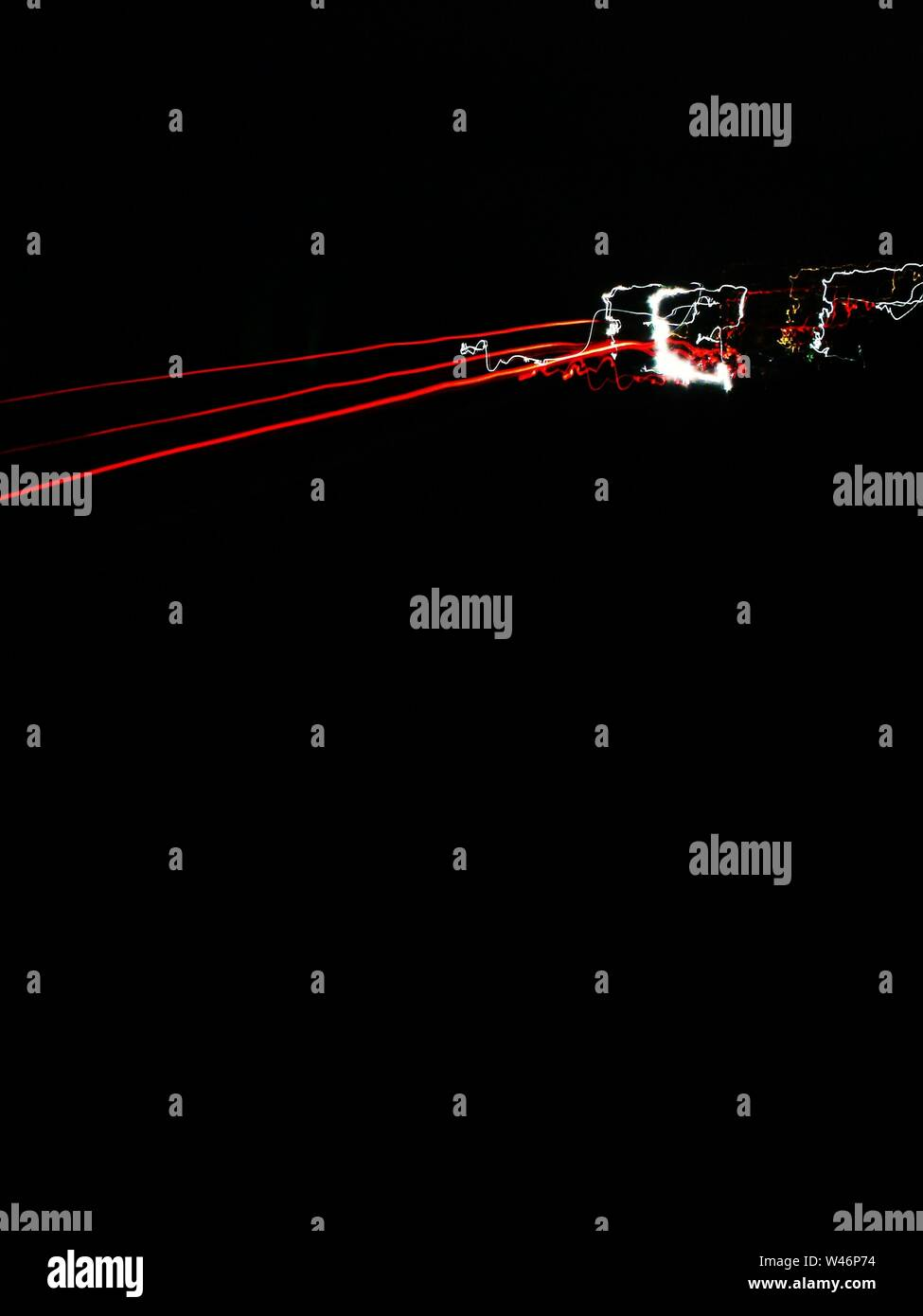 A Cool Vertical Wallpaper With Red And White Light Trails On A