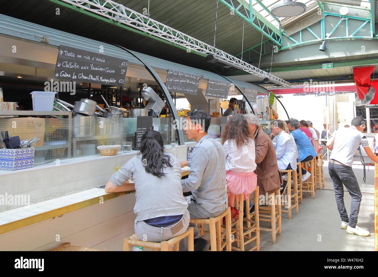 People visit Marche des Enfants Rouges market Paris France Stock Photo