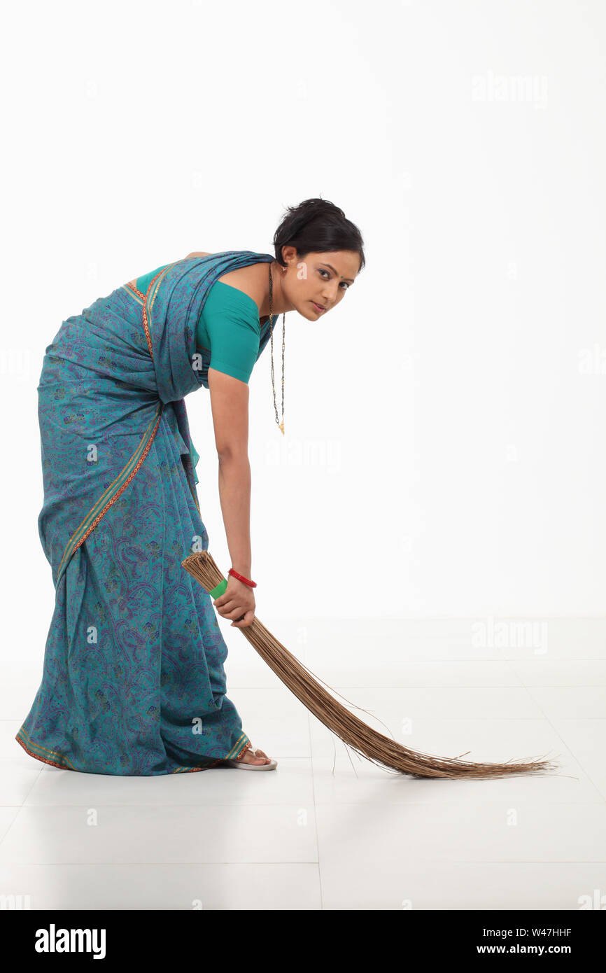 black woman sweeping high resolution stock photography and images alamy https www alamy com woman sweeping floor with broom image260781627 html