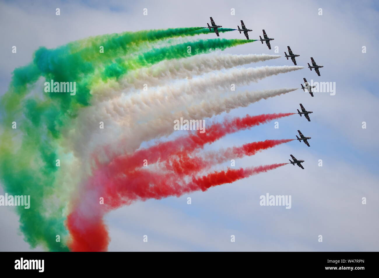 Fairford, UK. 20th July 2019. Frecce Tricolori displayed their colourful routine at RIAT Air Show at Fairford. © Uwe Deffner / Alamy Live News Stock Photo