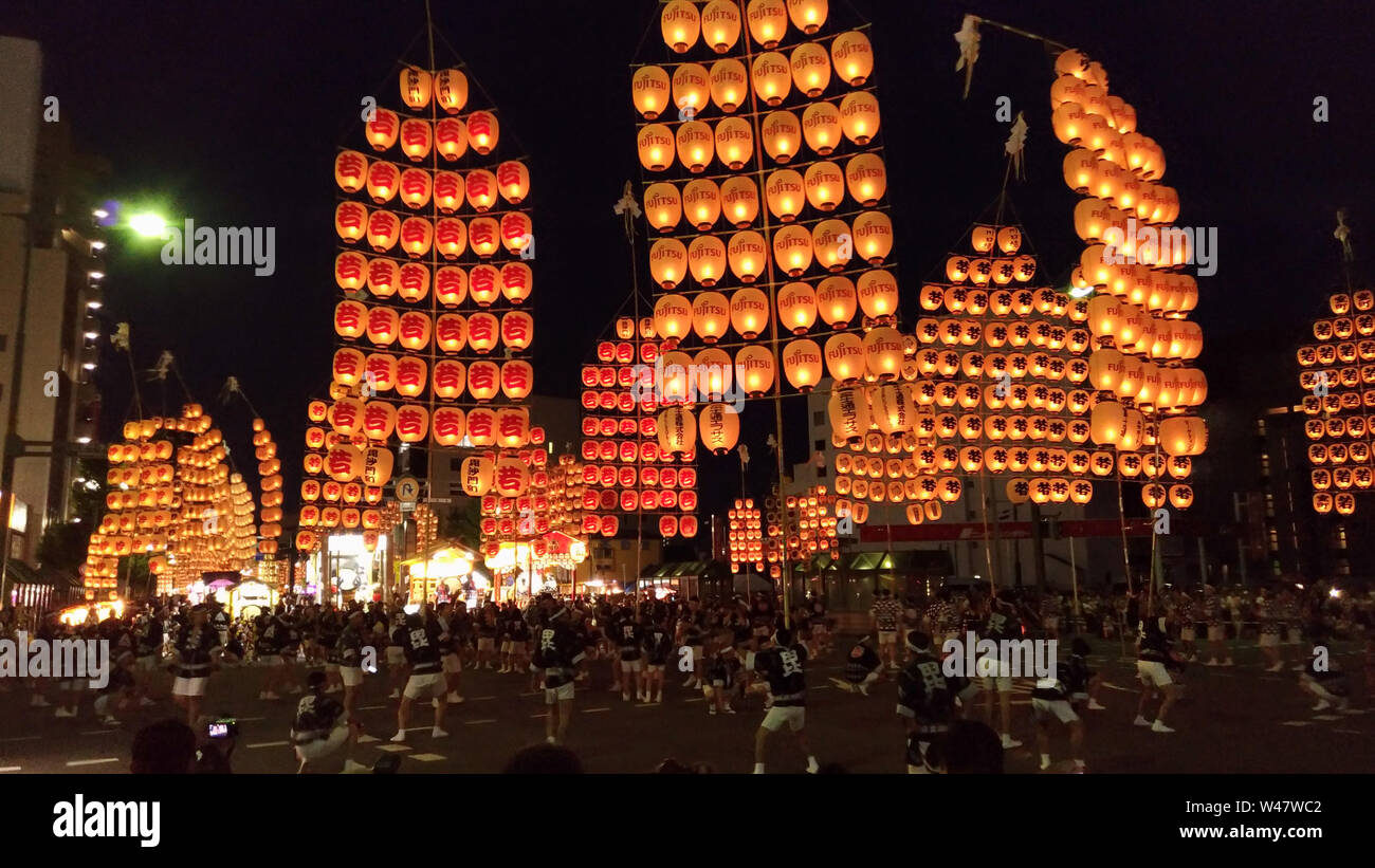 Akita Kanto Matsuri festival. a Japanese festival celebrated from 3–7 August, hope for good harvest. A long bamboo poles bearing lanterns are carried Stock Photo