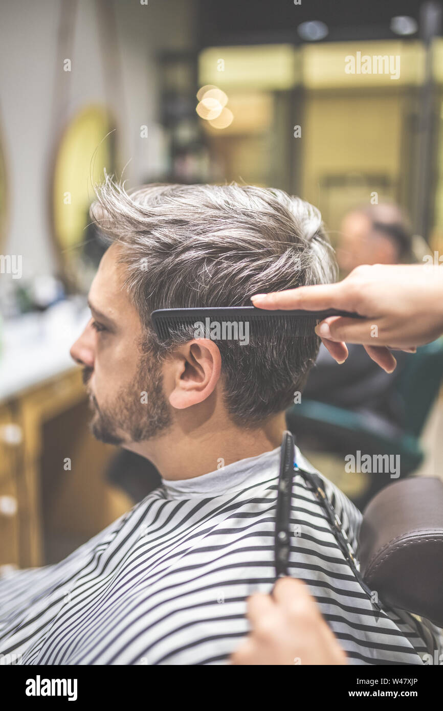 Men Hairstyling And Haircut In A Barber Shop Or Hair Salon Stock Photo Alamy