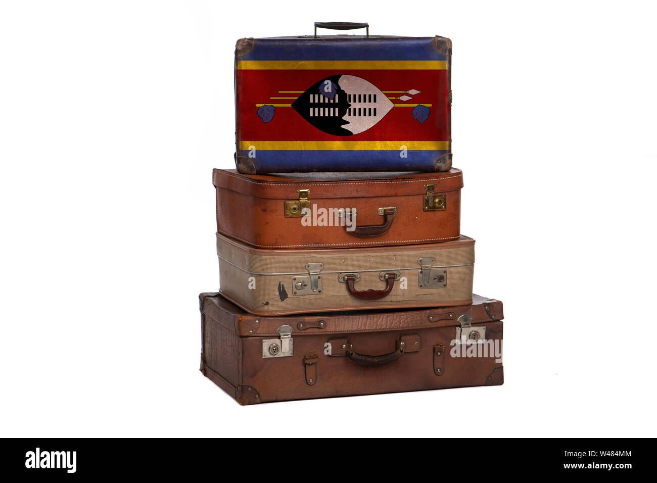 Swaziland, Swazi travel concept. Group of vintage suitcases isolated on white background Stock Photo
