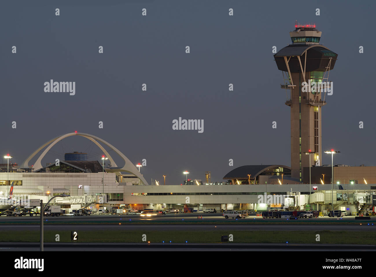 Image showing the landmark Theme Building and the control tower at the Los Angeles Anternational Airport, LAX.. Stock Photo