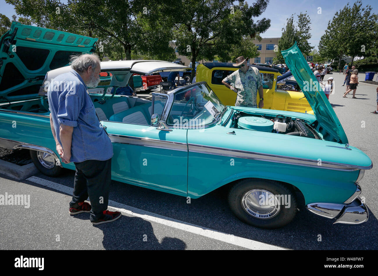 Coquitlam, Canada  20th July, 2019  People look at a 1959