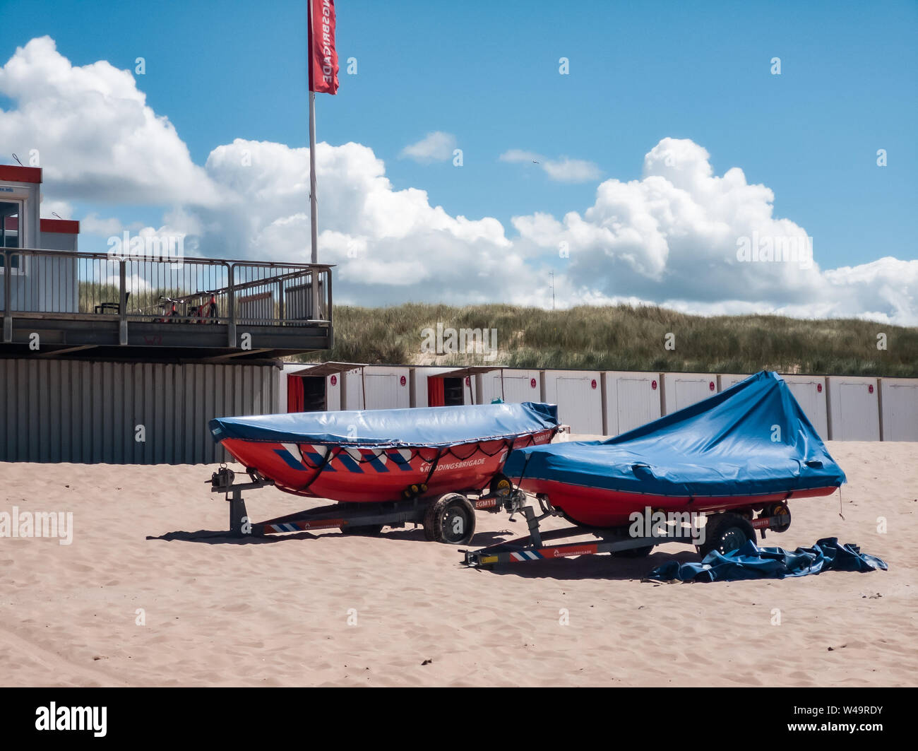 Egmond aan Zee, Netherlands - July 21, 2019: lifesaving ships of the dutch coastguard on the beach Stock Photo