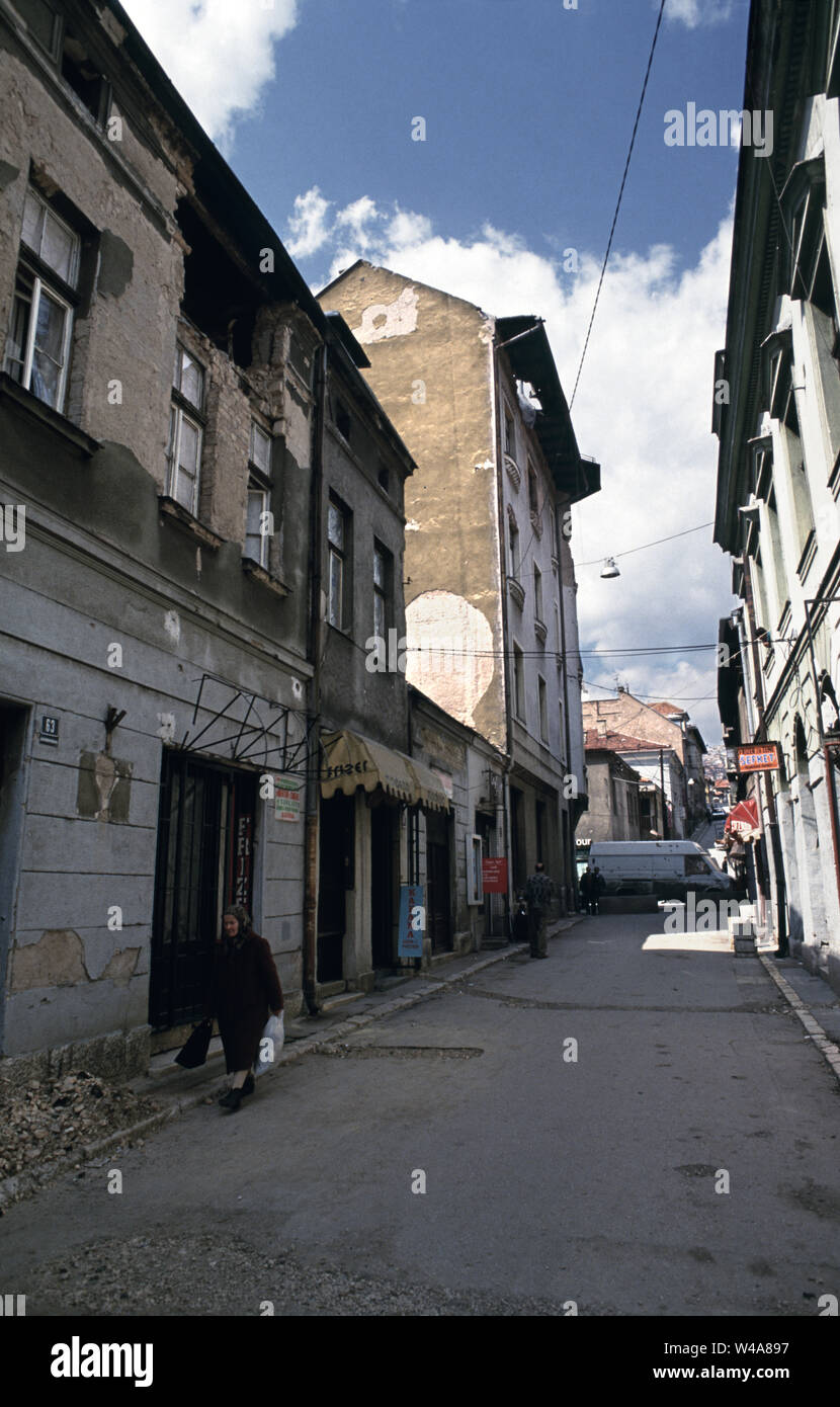 21st April 1993 During the Siege of Sarajevo: the view north along Gazi Husrev Begova in the old town area. - Stock Image