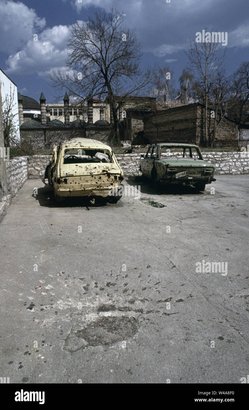 "21st April 1993 During the Siege of Sarajevo: a ""Sarajevo rose"", the ubiquitous scar of a mortar bomb, in a small parking area off Saraci Street in the Bascarsija area. - Stock Image"
