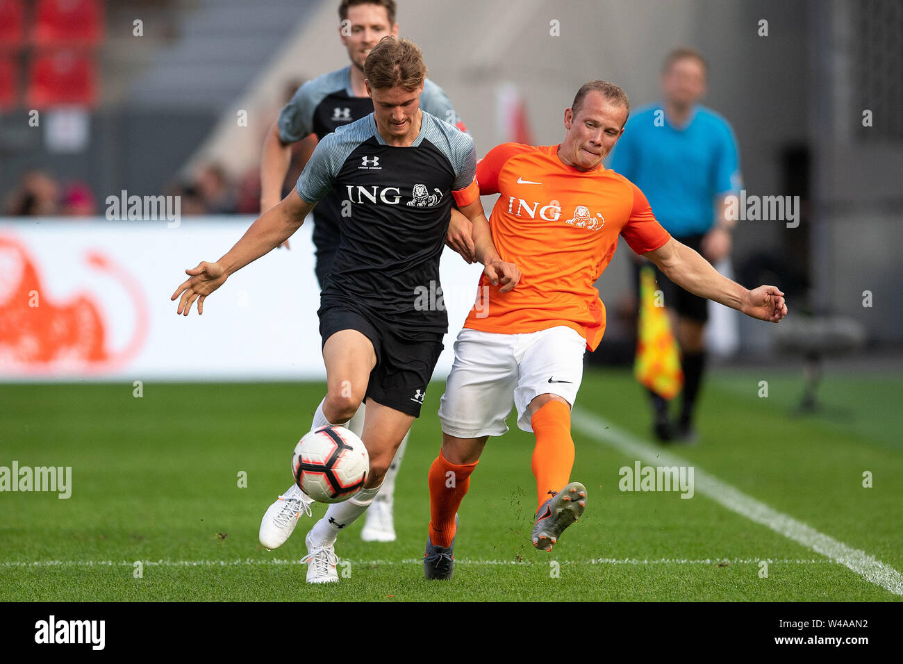 Leverkusen, Germany. 21st July, 2019. Soccer: Benefit soccer game 'Champions for Charity' in the BayArena. Racing driver Mick Schumacher (l) and former gymnast Fabian Hambüchen fight for the ball. Credit: Marius Becker/dpa/Alamy Live News - Stock Image