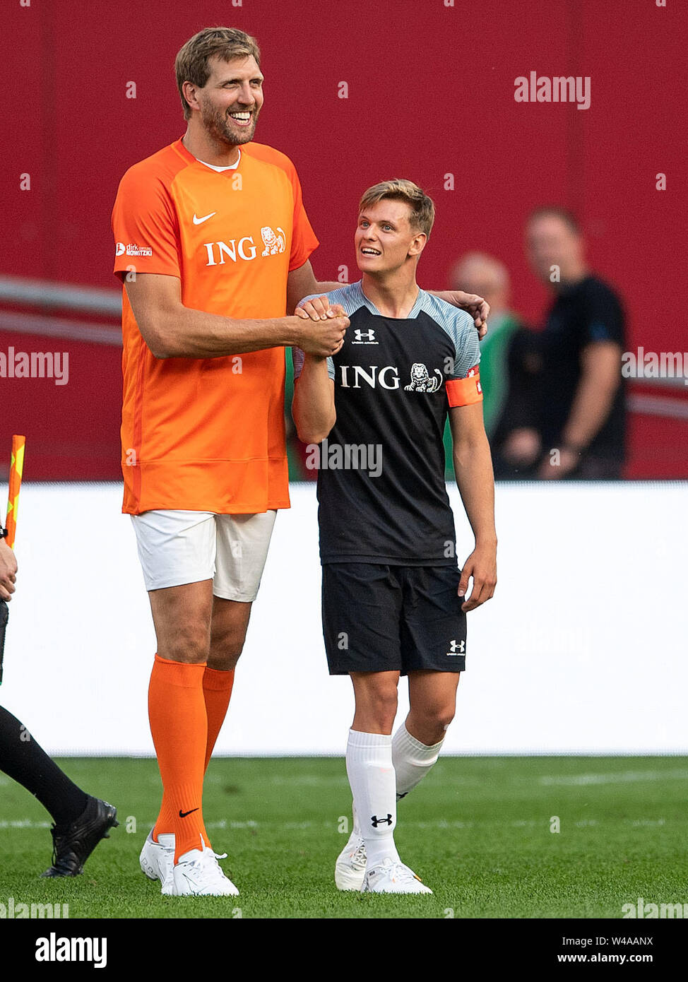 Leverkusen, Germany. 21st July, 2019. Soccer: Benefit soccer game 'Champions for Charity' in the BayArena. Former basketball player Dirk Nowitzki (l) and racing driver Mick Schumacher clap their hands during the match. Credit: Marius Becker/dpa/Alamy Live News - Stock Image