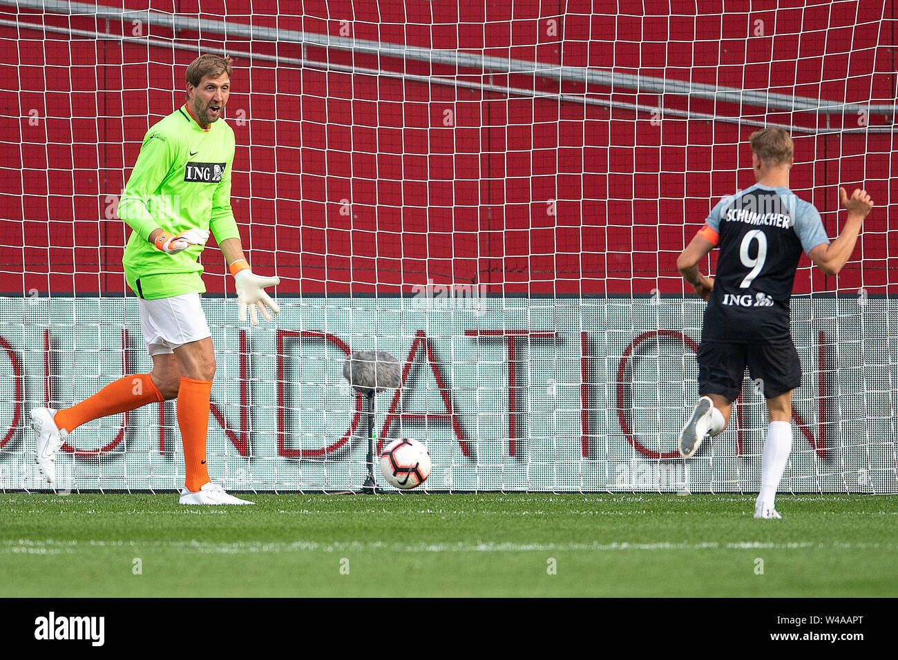 Leverkusen, Germany. 21st July, 2019. Soccer: Benefit soccer game 'Champions for Charity' in the BayArena. Racing driver Mick Schumacher (r) takes 1-0 lead against former basketball player Dirk Nowitzki. Credit: Marius Becker/dpa/Alamy Live News - Stock Image