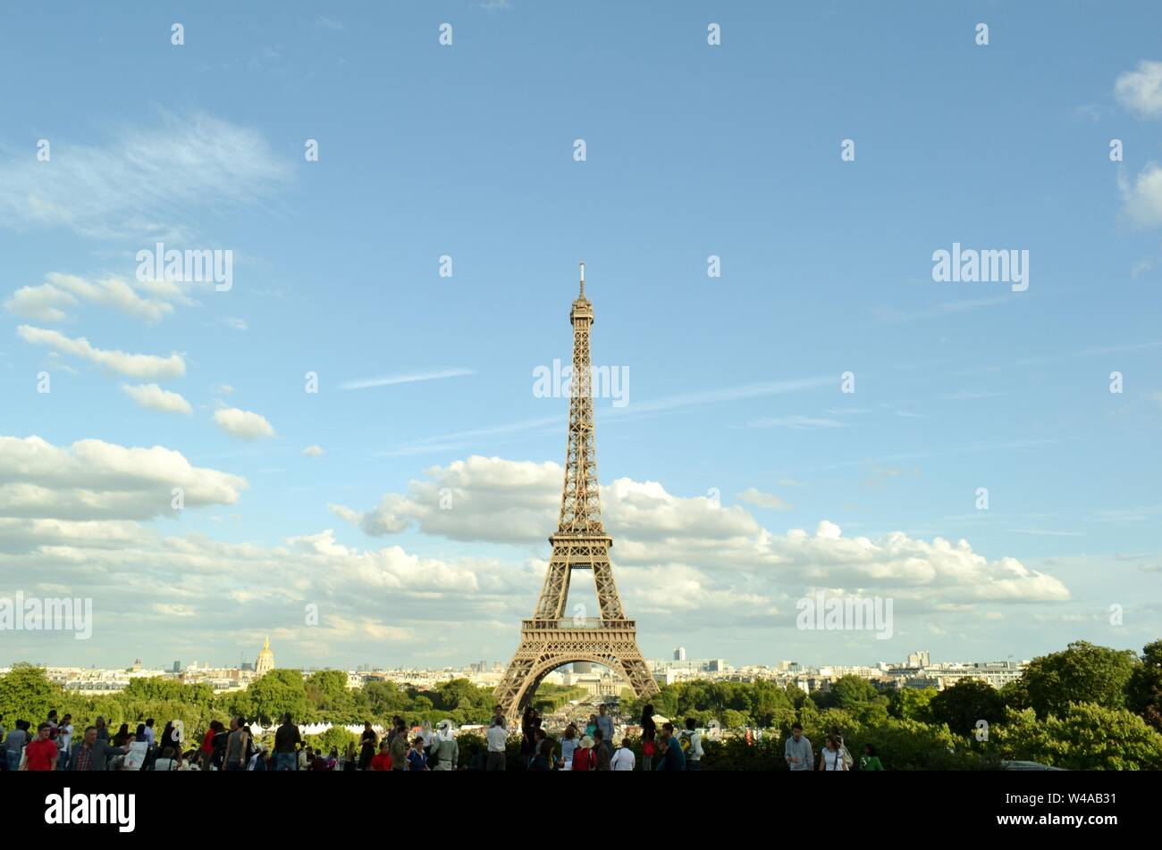 Paris/France - August 18, 2014: Beautiful panoramic view to the Eiffel Tower from Trocadero gardens viewpoint with tourists admiring the city. Stock Photo