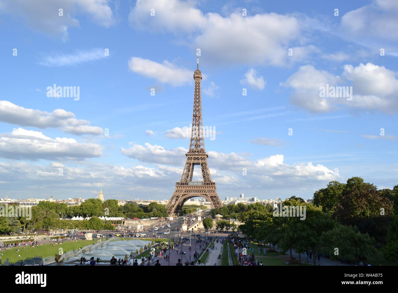 Paris/France - August 18, 2014: Beautiful panoramic view to the fountain of Warsaw and the Eiffel Tower from Trocadero gardens viewpoint. Stock Photo