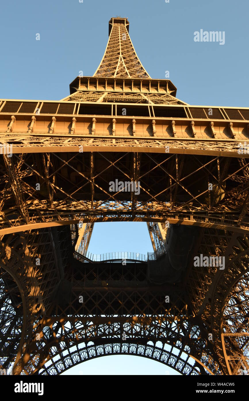 View to the Paris Eiffel Tower complex structure from the ground. Stock Photo