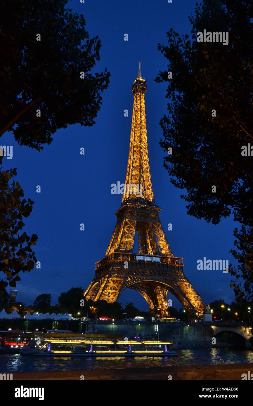 Beautiful panoramic view to the Eiffel Tower illuminated by night. Stock Photo