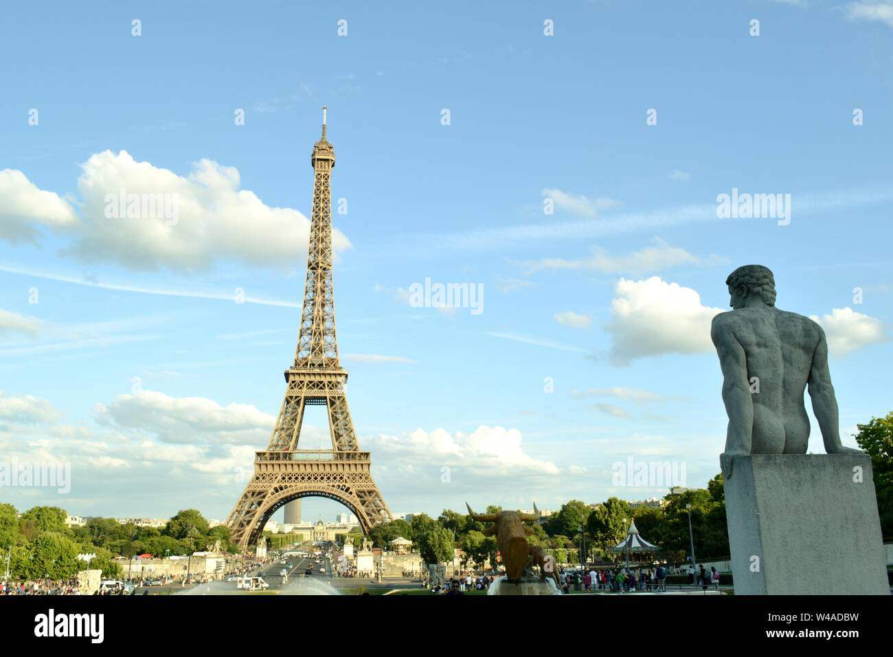 View to the statue called Man, l' Homme, at the fountain of Warsaw and the Eiffel Tower in the background. Stock Photo