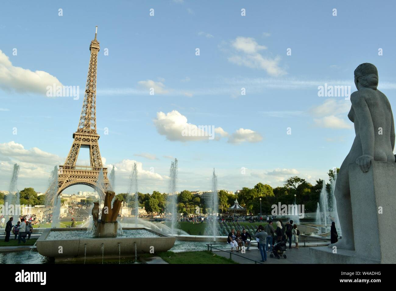 Paris/France - August 18, 2014: View to the statue called Woman, la Femme, of the fountain of Warsaw and the Eiffel Tower in the background. Stock Photo