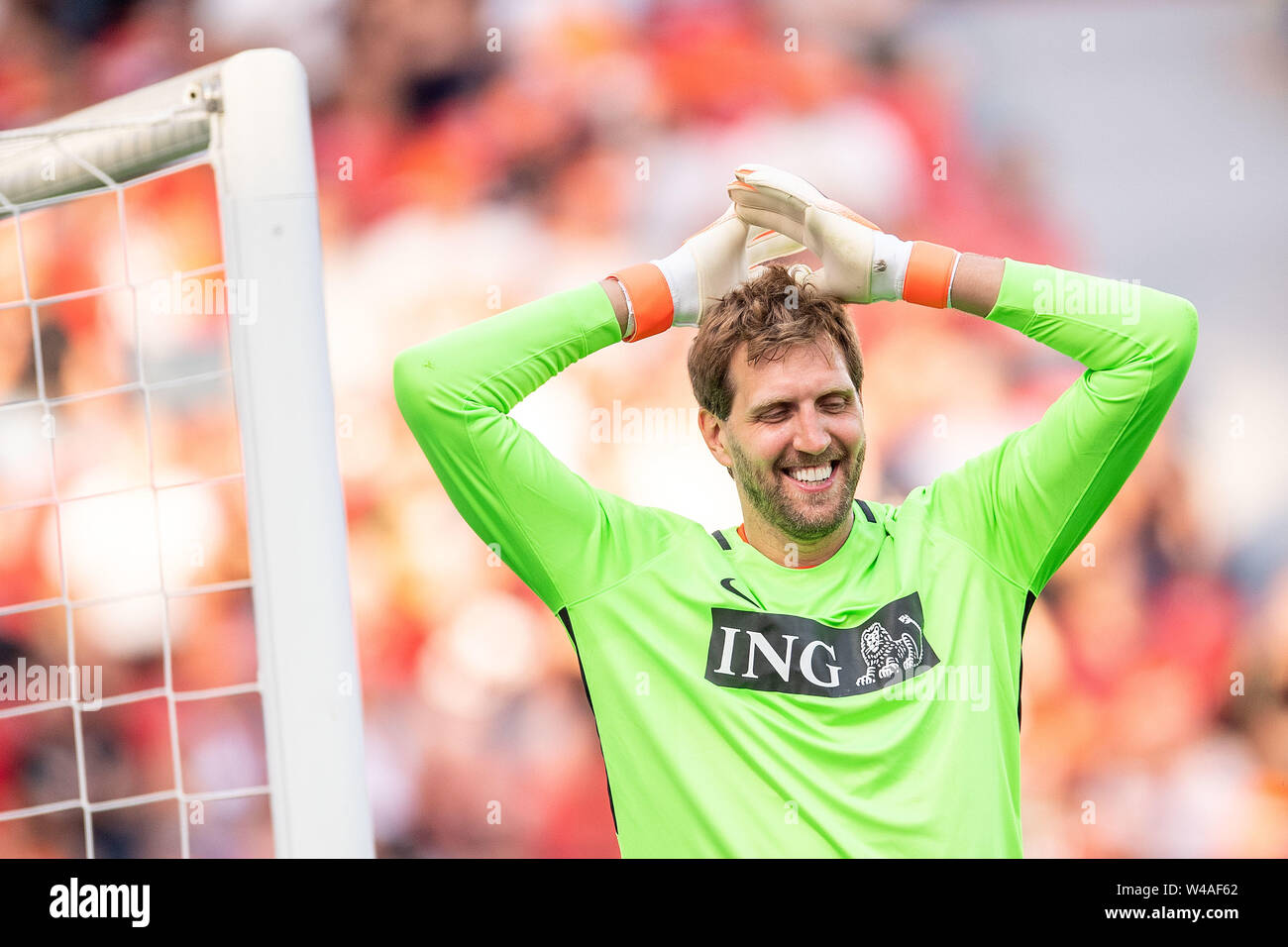 Leverkusen, Germany. 21st July, 2019. Soccer: Benefit soccer game 'Champions for Charity' in the BayArena. Former basketball player Dirk Nowitzki reacts after scoring a goal. Credit: Marius Becker/dpa/Alamy Live News - Stock Image