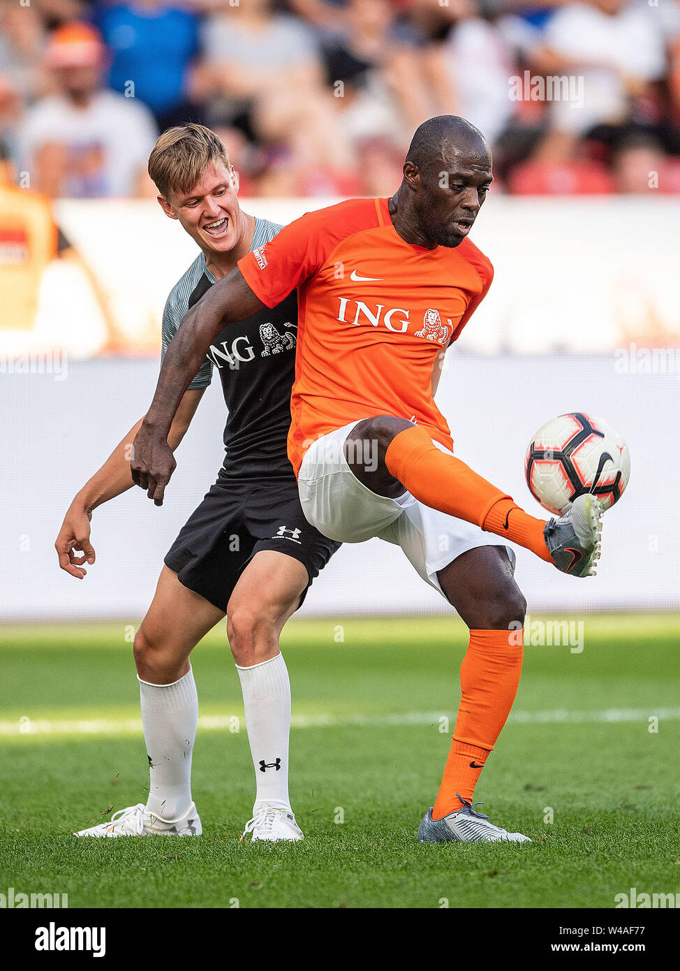 Leverkusen, Germany. 21st July, 2019. Soccer: Benefit soccer game 'Champions for Charity' in the BayArena. Racing driver Mick Schumacher (l) and former footballer Hans Sarpei fight for the ball. Credit: Marius Becker/dpa/Alamy Live News - Stock Image