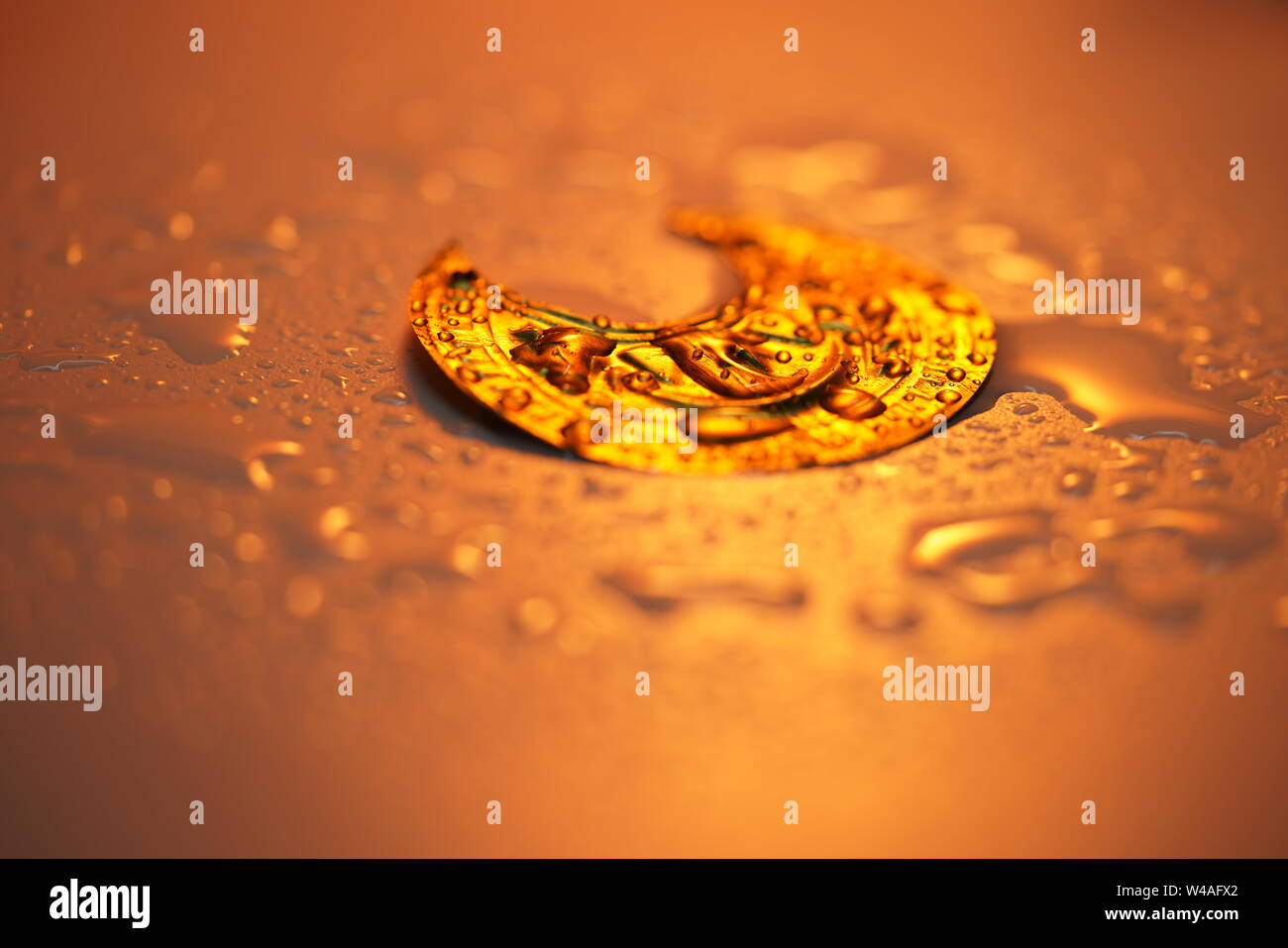 Drops on the glass tablets under tinted lighting Stock Photo