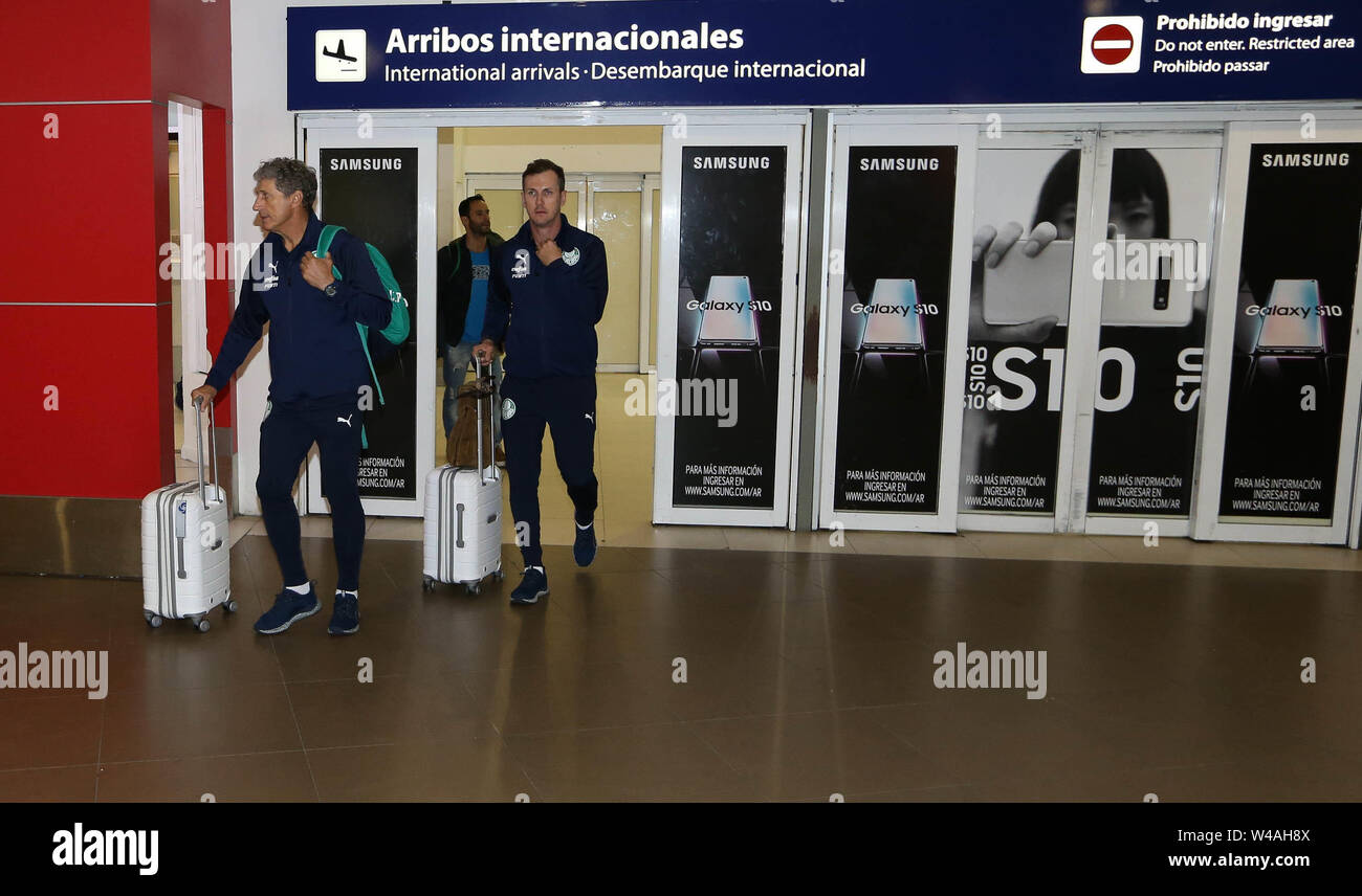 Buenos Aires, Argentina. 21st July, 2019. Assistant technicians Carlos Pracidelli and Paulo Turra (D) of SE Palmeiras during disembarkation at Buenos Aires International Airport. Credit: Cesar Greco/FotoArena/Alamy Live News - Stock Image