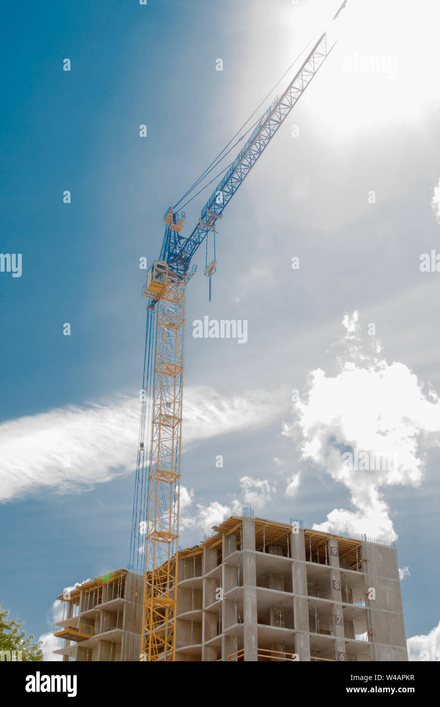 Modern building under construction detail, concrete frame, indow openings and scaffolding Stock Photo