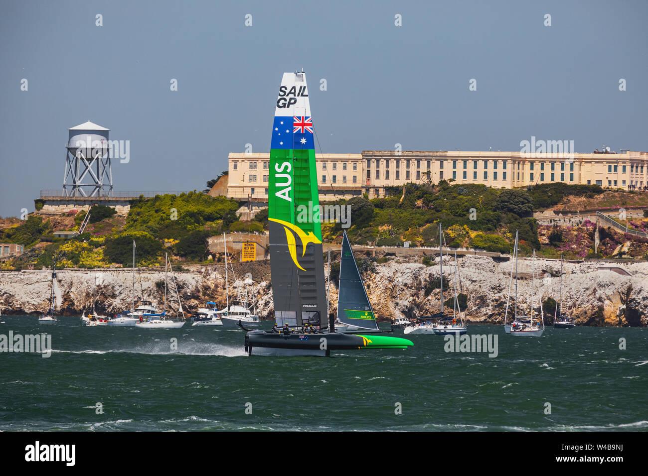 SailGP team France on the San Francisco Bay flying in front of Alcatraz Stock Photo