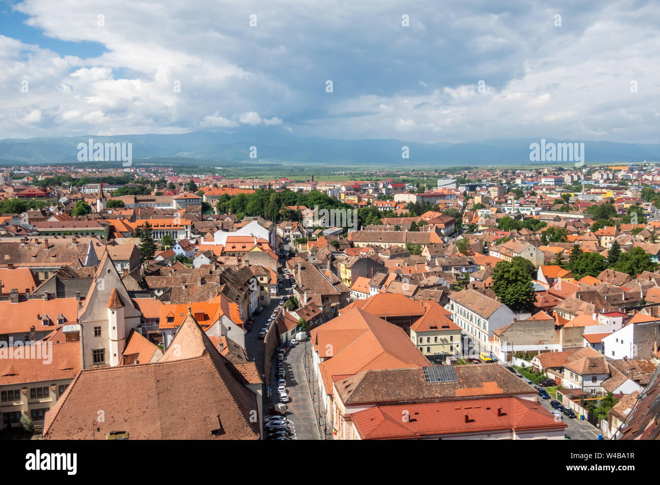 Broad panorama from the Lutheran Cathedral of Saint Mary in Sibiu, Transylvania, Romania. Casa Altemberger, the Carpathian mountains Stock Photo