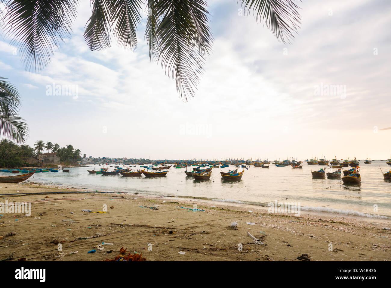 Moored fishing boats at sunset, vietnam Stock Photo