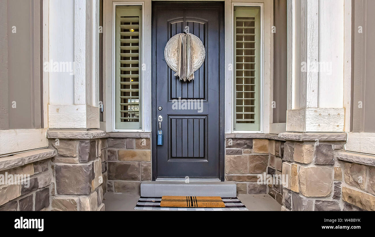 Panorama Home Entrance With A Gray Front Door In The Middle