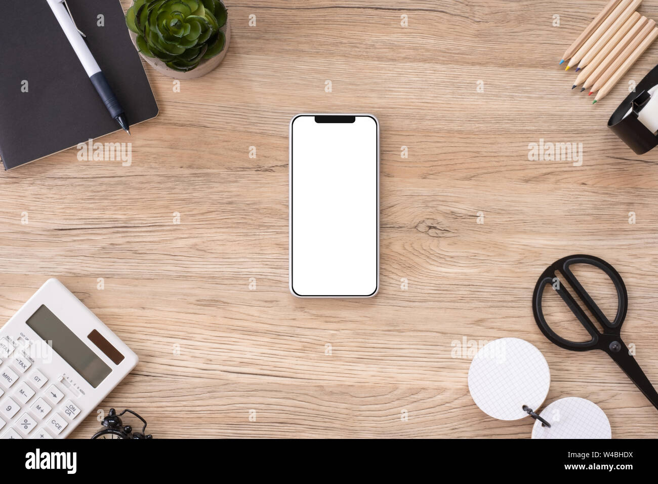 Mobile Mock Up On Office Desk Table Top View With Stationery ...