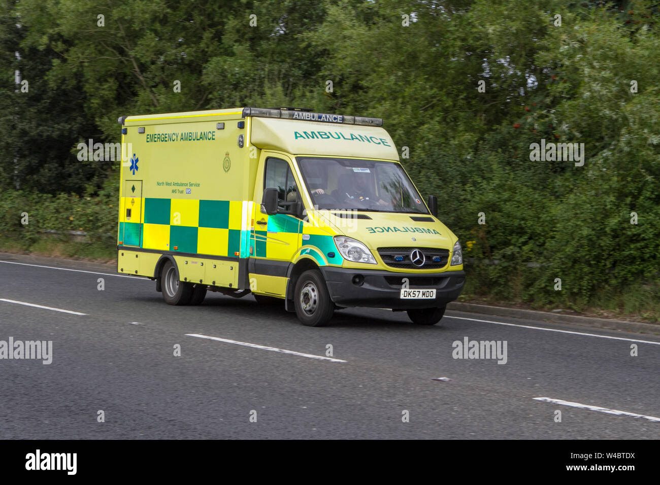 Emergency ambulance medic medics medical paramedic injury injured transport mercedes sprinter Stock Photo